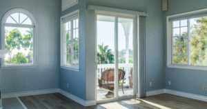 Sunny Blue Room with new windows and a sliding door